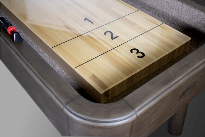 "Close up of the collins shuffleboard for the article ""How to clean and wax a shuffleboard"""