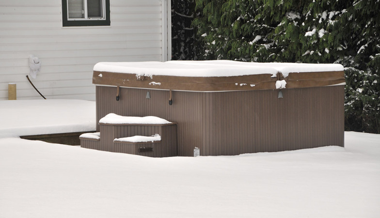 An image of a hot tub covered in snow