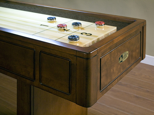 Sterling shuffleboard with cabinet is a popular game room idea