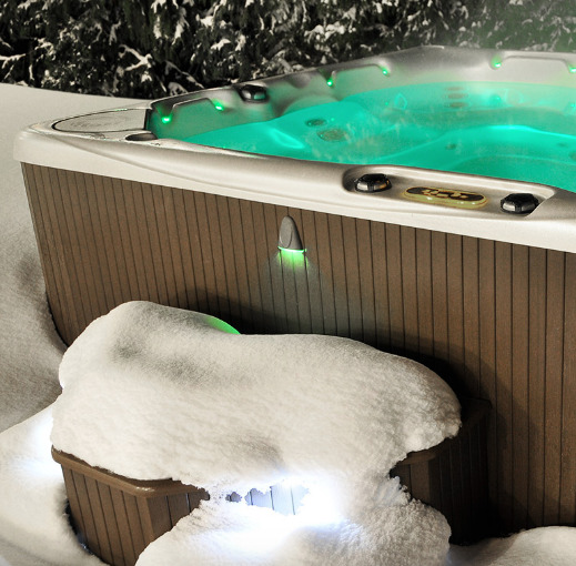 Hot tub rules can save you loads of headaches and money in the long run. Image of Beachcomber hot tub with blue lights