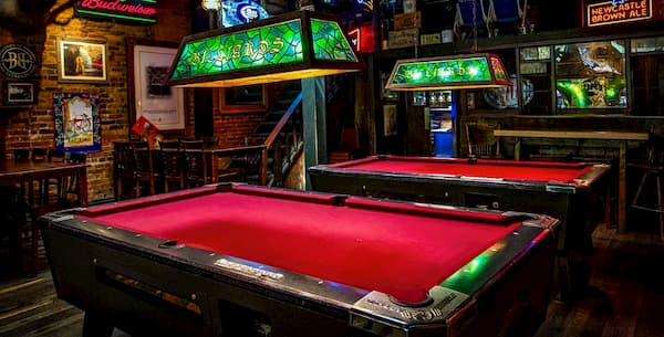HOW HIGH SHOULD LIGHTS HANG OVER A BILLIARDS TABLE?