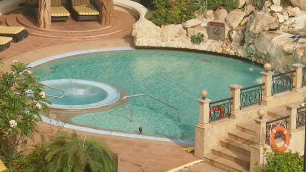 Combination of a pool and spa