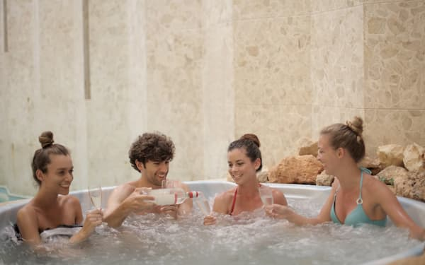 One guy with three girls demonstrating perfect hot tub etiquette