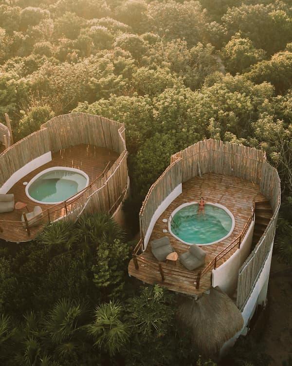 In-ground hot tub built into a secret enclave