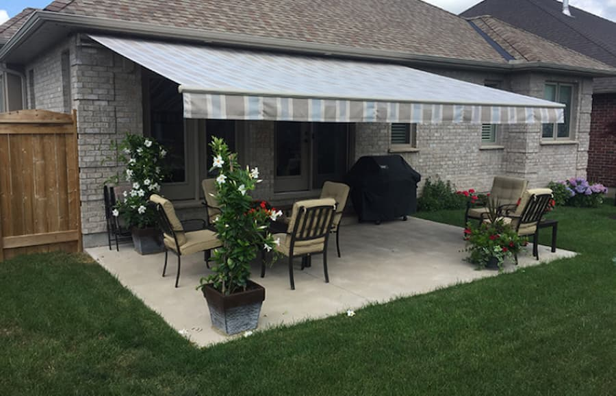 Patio with awning makes for one of the best patio ideas for outdoor season