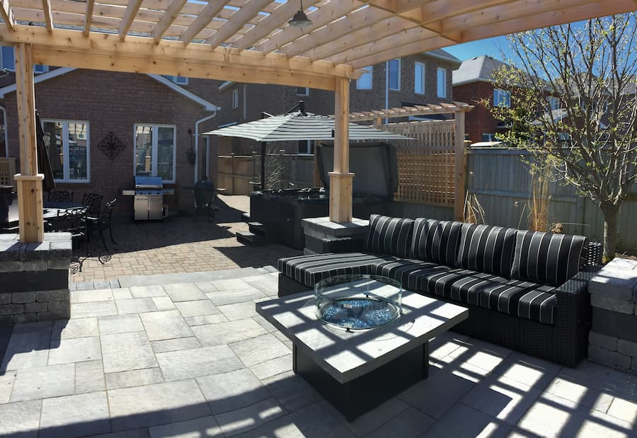 Sectional couch, fire pit and cantilever umbrella over the hot tub