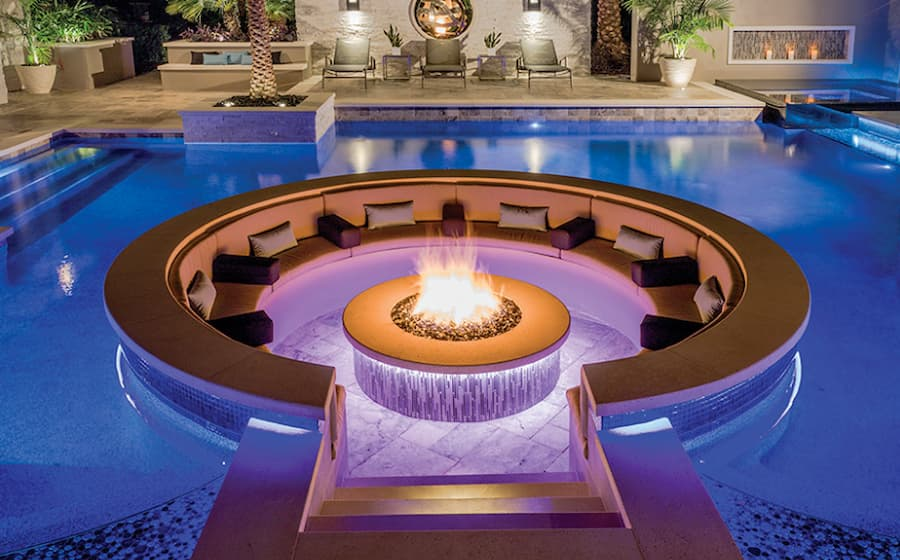 Fire pit in the middle of a swimming pool is one of the 7 outdoor patio ideas: Create a focal point