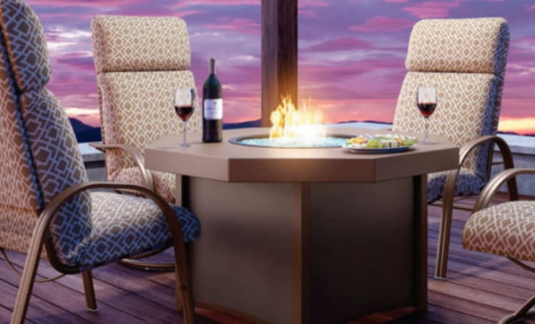 The best outdoor patio furniture ideas include fire table at night