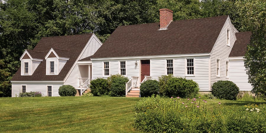 Shingle colour contrasts siding for a great look