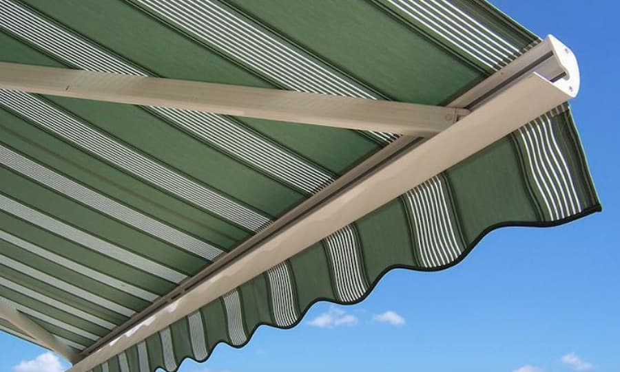 Installing this greena nd white retractable awning is one of the outdoor patio ideas for the summer