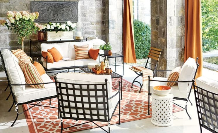 Create a corner with two loveseats in your backyard patio furniture arrangement