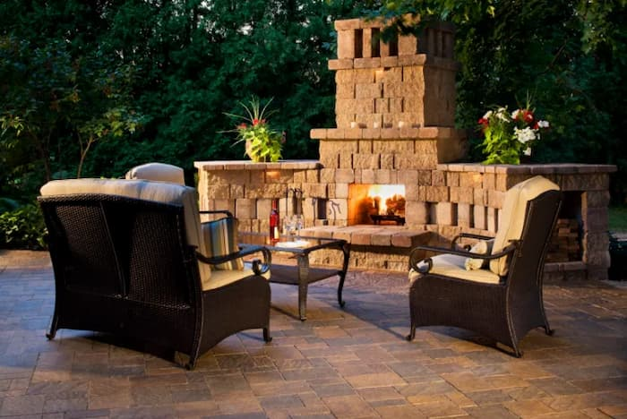 Custom outdoor fireplace built in stone