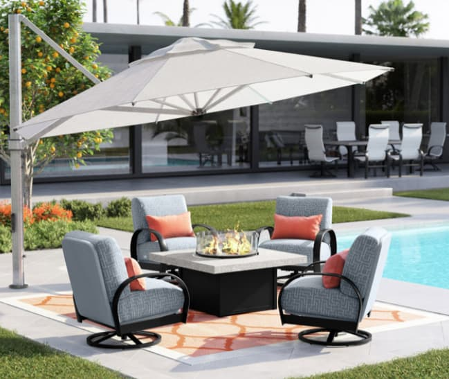 Propane fire pit table under a cantilever umbrella and surrounded with deep seating