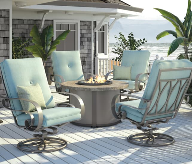 Home crest propane fire pit table surrounded with deep seating patio furniture