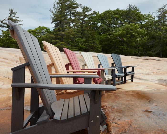 Adirondack and Muskoka chairs lined up on the beach