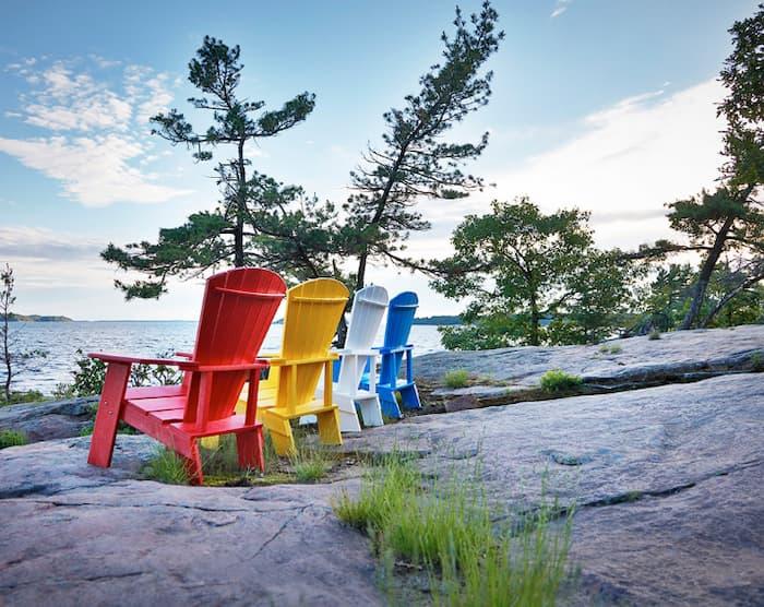 rainbow coloured muskoka and adirondack chairs